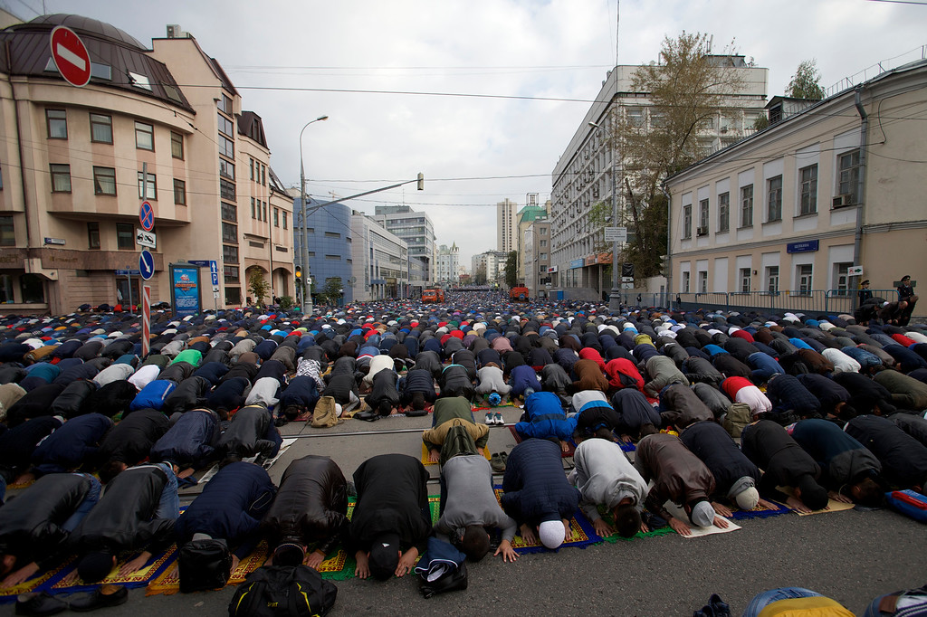. Muslims pray outside a mosque during celebrations of Eid al-Adha, a feast celebrated by Muslims worldwide, which Muslims in Russia call Kurban-Bairamin Moscow, Russia, on Monday, Sept. 12, 2016. (AP Photo/Ivan Sekretarev)