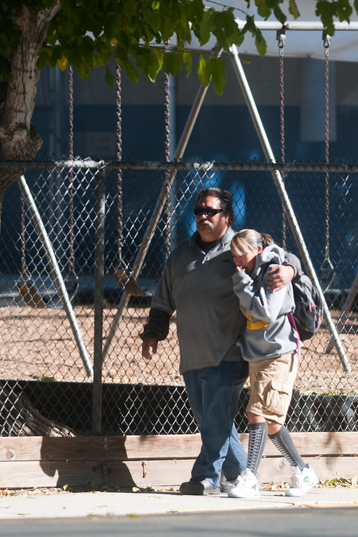 . A parent escorts his child from Agnes Risley Elementary school following a shooting at nearby Sparks Middle School October 21, 2013 in Sparks, Nevada.   (Photo by David Calvert/Getty Images)