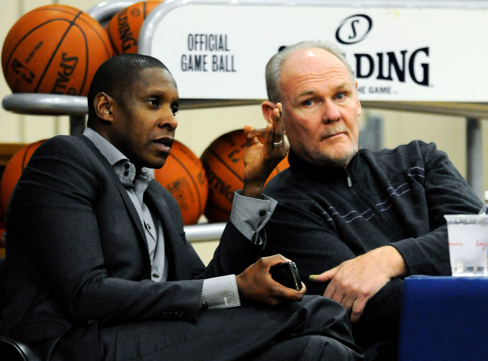 . Denver Nuggets executive vice president of basketball operations Masai Ujiri, left, talks with head coach George Karl during the first day of NBA basketball training camp in Denver. Ujiri was named the NBA\'s executive of the year on Thursday, May 9, 2013, a day after Karl was named the league\'s top coach. (AP Photo/Jack Dempsey, File)