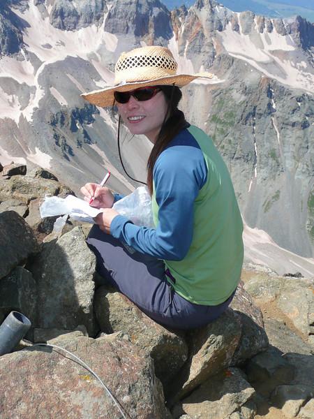 Sabrina signing the summit log...