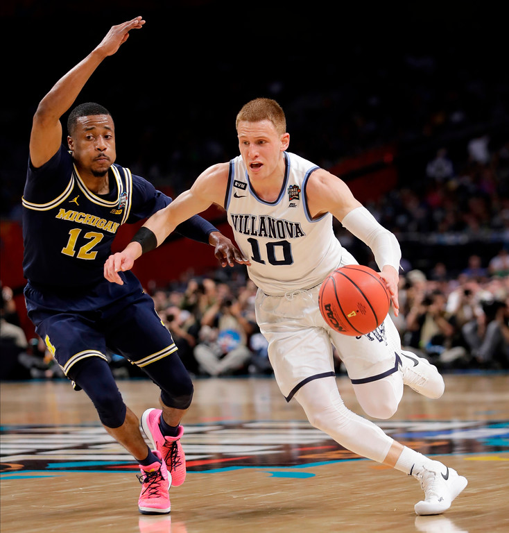 . Villanova\'s Donte DiVincenzo (10) drives past Michigan\'s Muhammad-Ali Abdur-Rahkman (12) during the first half in the championship game of the Final Four NCAA college basketball tournament, Monday, April 2, 2018, in San Antonio. (AP Photo/Eric Gay)