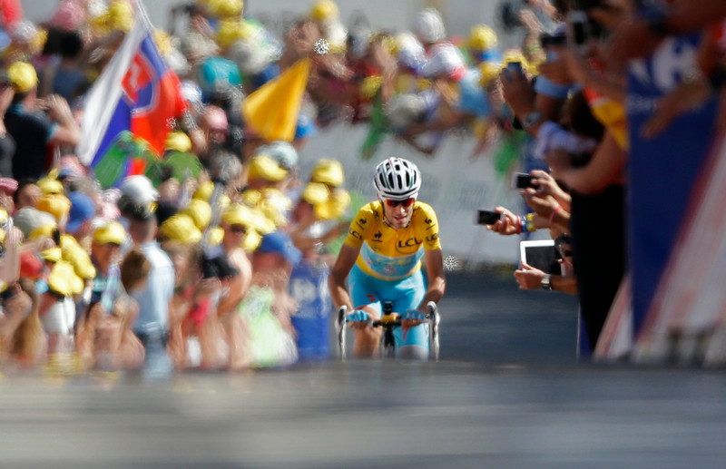 . Italy\'s Vincenzo Nibali crosses the finish line to win the thirteenth stage of the Tour de France cycling race over 197.5 kilometers (122.7 miles) with start in Saint-Etienne and finish in Chamrousse, France, Friday, July 18, 2014. (AP Photo/Peter Dejong)