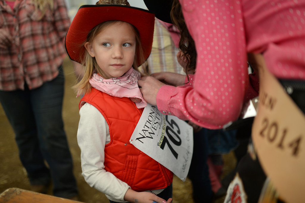 . DENVER, CO. JANUARY 25: Kira Butchart, 6, is preparing for the stick horse rodeo at Ames Activity Pavilion at the National Western Stock Show in Denver, Colorado January 25, 2014. Twenty-eight children competed in the event. (Photo by Hyoung Chang/The Denver Post)
