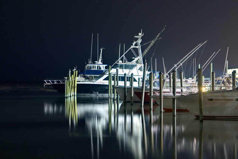 Several boats calmly float at the Crazy Sister Marina at the Marshwalk in Murrells Inlet, SC on Tuesday, April 21, 2015. Copyright 2015 Jason Barnette