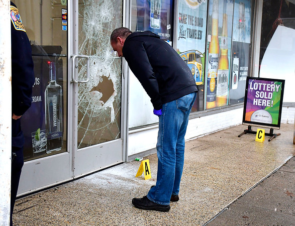 2/11/2020 Mike Orazzi | Staff Bristol Police Detective Scott Hayden collects evidence at the Liquor Outlet on Riverside Avenue after an overnight burglary occurred.