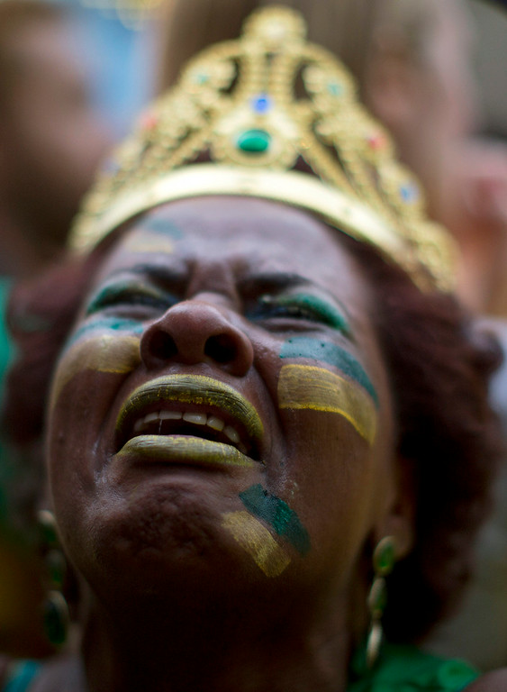 . A Brazil soccer fan weeps as she watches Germany score repeatedly against Brazil at a World Cup semifinal match on a live telecast inside the FIFA Fan Fest area in Sao Paulo, Brazil, Tuesday, July 8, 2014. (AP Photo/Dario Lopez-Mills)