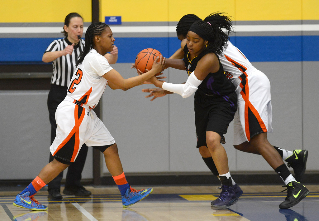 . McClymonds High\'s Ny\' Dajah Jackson (22), left and Breannie Robinson (23) battle Oakland Tech High\'s London Robinson (33) for a loose ball in their Oakland Section high school girls basketball championship game played at Merritt College in Oakland, Calif. on Thursday, Feb. 28, 2013. (Dan Honda/Staff)