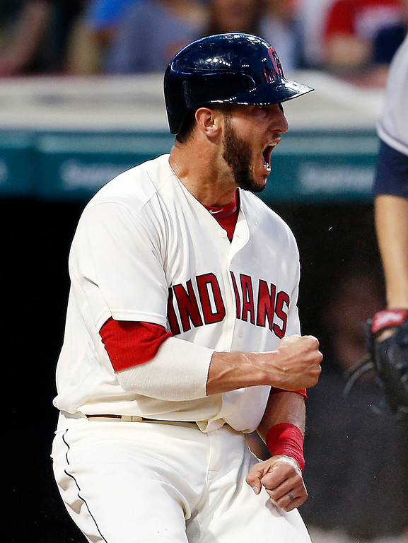 . Cleveland Indians\' Yan Gomes celebrates after scoring on a sacrifice fly by Rajai Davis against the Tampa Bay Rays during the seventh inning of a baseball game, Monday, June 20, 2016, in Cleveland. (AP Photo/Ron Schwane)