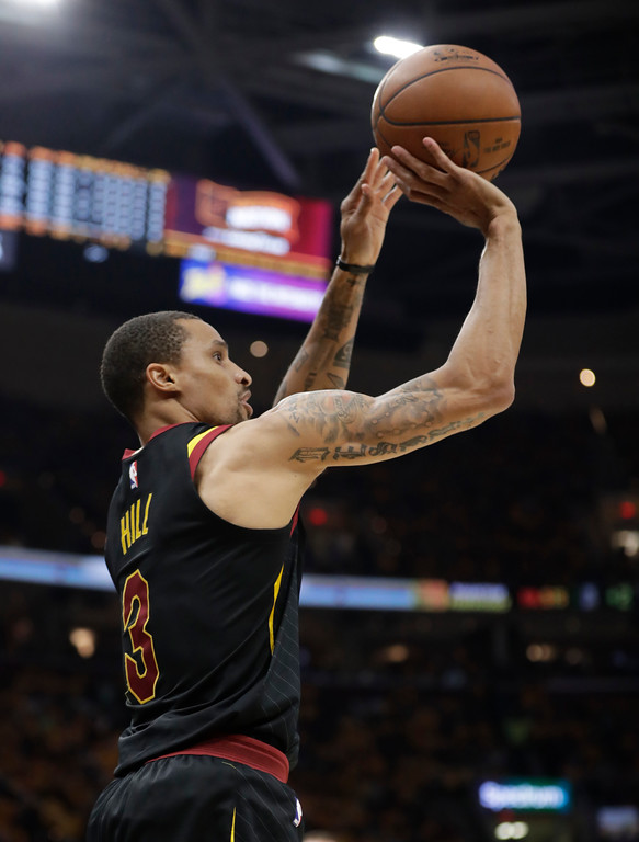 . Cleveland Cavaliers\' George Hill (3) shoots against the Boston Celtics in the first half of Game 3 of the NBA basketball Eastern Conference finals, Saturday, May 19, 2018, in Cleveland. (AP Photo/Tony Dejak)