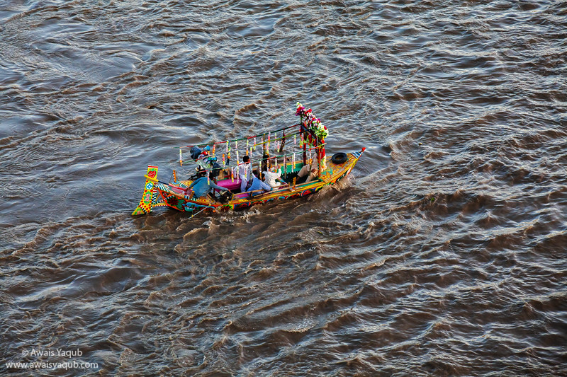 Colorful boat floating in indus river