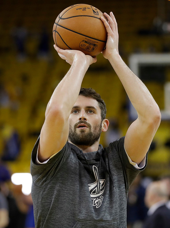 . Cleveland Cavaliers forward Kevin Love warms up before Game 5 of basketball\'s NBA Finals between the Golden State Warriors and the Cavaliers in Oakland, Calif., Monday, June 12, 2017. (AP Photo/Marcio Jose Sanchez)