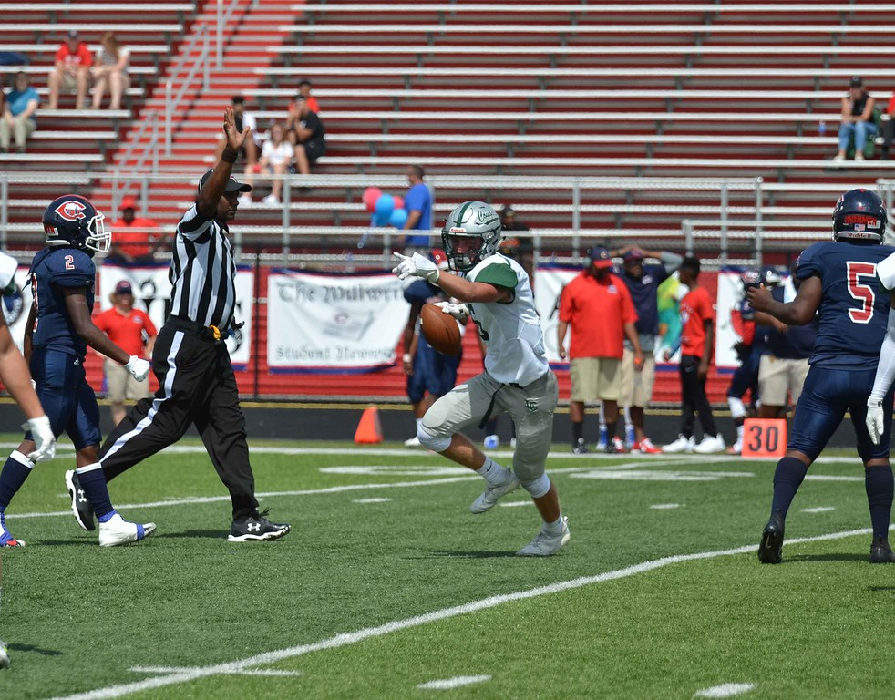 . Paul DiCicco - The News-Herald Action from Lake Catholic-Cleveland Central Catholic on Sept. 1.