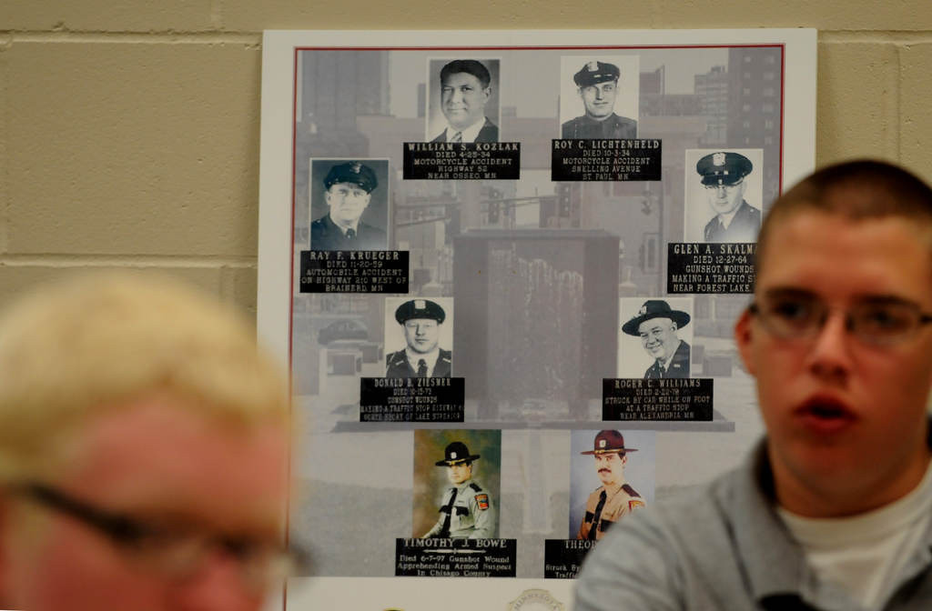 . In the back of a classroom is a poster of State Troopers killed in the line duty.  At right is Tyler Freeman of St. Paul Park. (Pioneer Press: Jean Pieri)