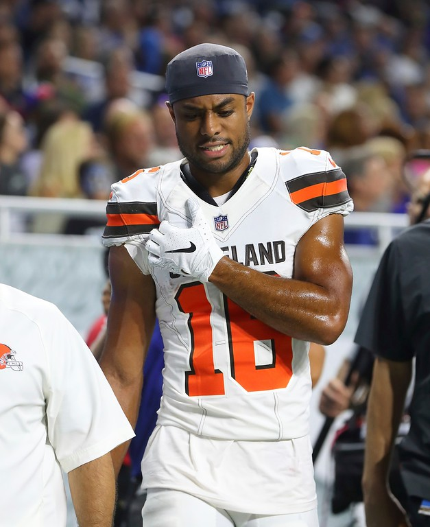 . Cleveland Browns wide receiver C.J. Board walks off the field for medical observation during the first half of an NFL football preseason game against the Detroit Lions, Thursday, Aug. 30, 2018, in Detroit. (AP Photo/Paul Sancya)