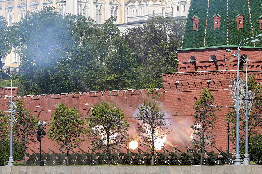 . Russian cannons at the Kremlin wall are fired during a Victory Day parade in Red Square, Russia, Friday, May 9, 2014. Russia marked the Victory Day on May 9 holding a military parade in Red Square in Moscow. (AP Photo/Denis Tyrin)