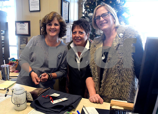 11/25/2017 Mike Orazzi   Staff Good Cause Gifts' Jill Marsh, Sharon Faucher and Nan Thibeault on Main Street in Berlin Saturday.