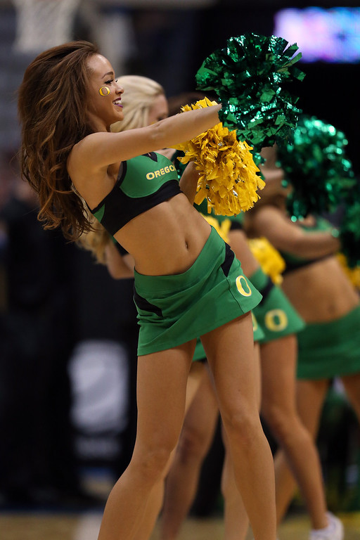 . The Oregon Ducks cheerleaders perform against the Wisconsin Badgers during the third round of the 2014 NCAA Men\'s Basketball Tournament at BMO Harris Bradley Center on March 22, 2014 in Milwaukee, Wisconsin.  (Photo by Jonathan Daniel/Getty Images)