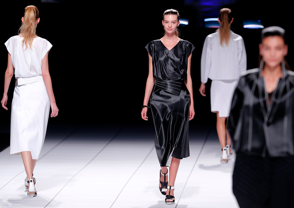 . Models present creation as part of Issey Miyake\'s ready-to-wear Spring/Summer 2014 fashion collection, presented Friday, Sept. 27, 2013 in Paris. (AP Photo/Jacques Brinon)