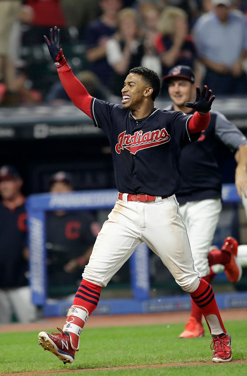 . Cleveland Indians\' Francisco Lindor celebrates after hitting a walk-off three-run home run against the Minnesota Twins in a baseball game Wednesday, Aug. 8, 2018, in Cleveland. The Indians won 5-2. (AP Photo/Tony Dejak)