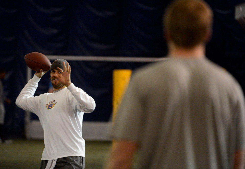 . Former Denver Broncos quarterback, Jake Plummer, left, throws to former Kansas State star quarterback, Collin Klein, right, coaching him inside the South Suburban Parks and Recreation\'s Sport Dome in Centennial, Colorado, Thursday morning, February 14th, 2013.  Plummer has spent weeks with Klein preparing him for the upcoming NFL Scouting Combine in Indianapolis, Indiana February 20th thru February 26th 2013. (Photo By Andy Cross / The Denver Post)