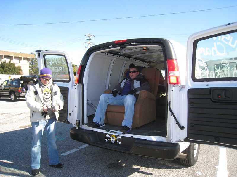 Robbie in their ride to the game. (yes they put recliners and couches in a cargo van)