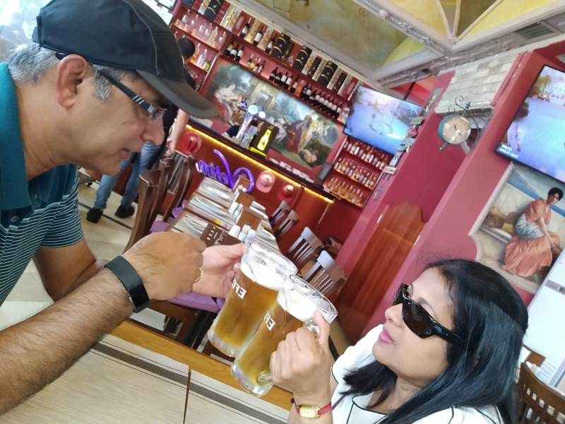 two people having a large beer