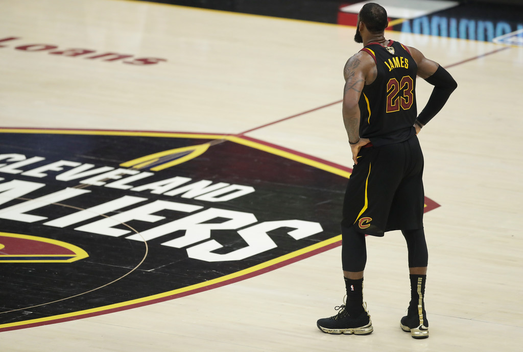. Cleveland Cavaliers\' LeBron James watches in the first half of Game 4 of basketball\'s NBA Finals against the Golden State Warriors, Friday, June 8, 2018, in Cleveland. (AP Photo/Tony Dejak)