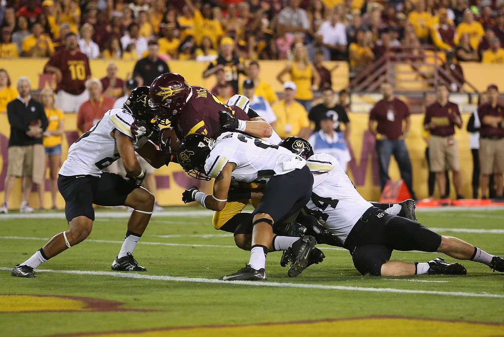 . TEMPE, AZ - OCTOBER 12:  Running back Marion Grice #1 of the Arizona State Sun Devils carries the football on a 8 yard rushing touchdown past the tackle from linebacker Addison Gillam #44 of the Colorado Buffaloes during the first quarter of the college football game at Sun Devil Stadium on October 12, 2013 in Tempe, Arizona.  (Photo by Christian Petersen/Getty Images)