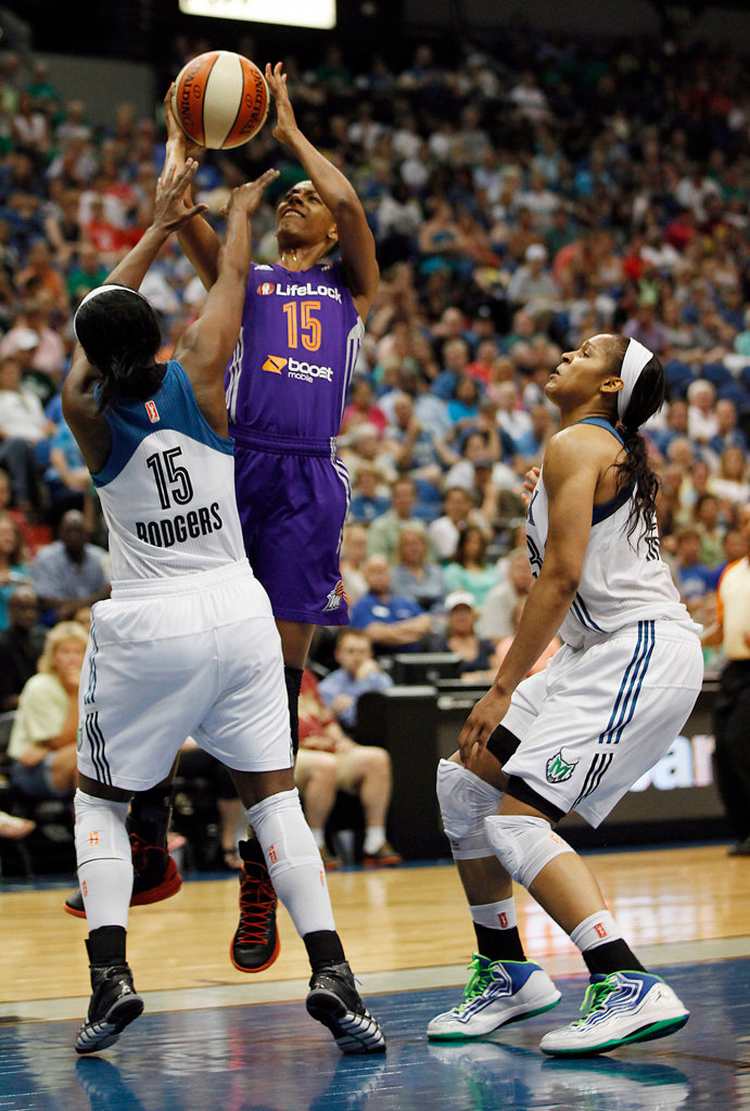 . Phoenix Mercury guard Briana Gilbreath (15) goes up to the basket against Minnesota Lynx guard Ta\'Shauna Rodgers (15) in the second half. (AP Photo/Stacy Bengs)