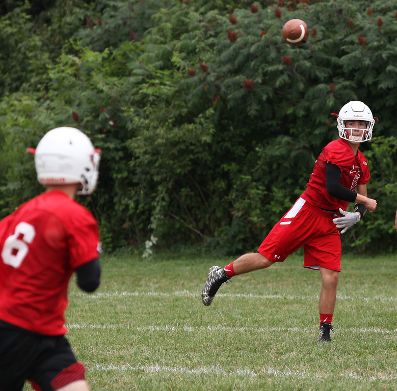 . Randy Meyers - The Morning Journal<br> Firelands quarterback Jacob Farley throws to a receiver during passing drills at Firelands\' first football practice on July 30.