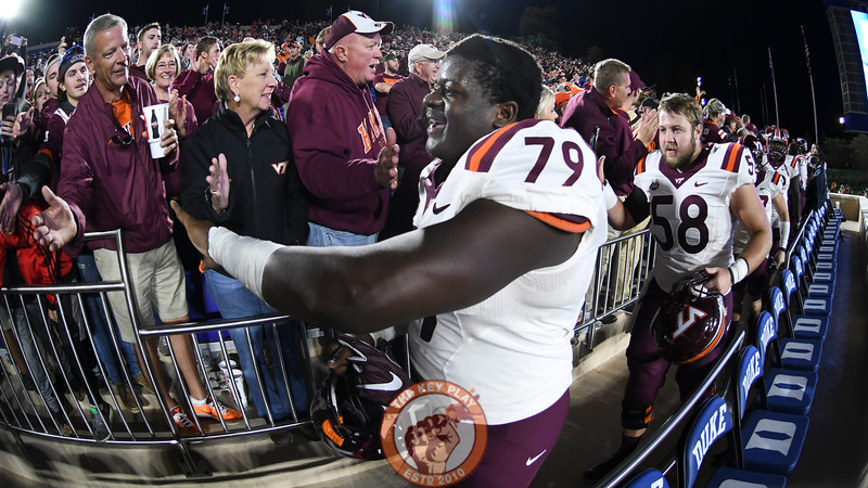 Virginia Tech offensive lineman Tyrell Smith (79) celebrates with fans following the victory. (Michael Shroyer/TheKeyPlay.com)