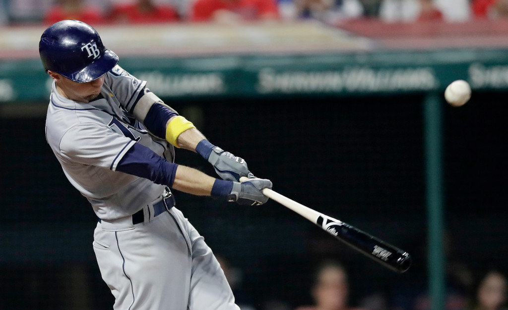 . Tampa Bay Rays\' Matt Duffy hits a two-run double in the sixth inning of a baseball game against the Cleveland Indians, Saturday, Sept. 1, 2018, in Cleveland. (AP Photo/Tony Dejak)