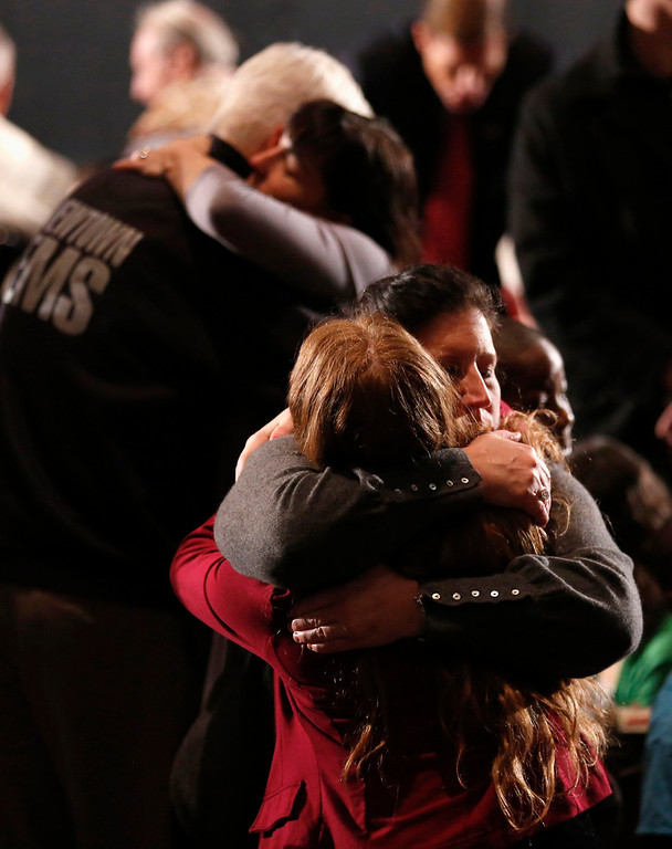. Women embrace at a vigil held at Newtown High School for families of the Sandy Hook Elementary School shooting victims in Newtown, Connecticut December 16, 2012. U.S. President Barack Obama is visiting Newtown High School to meet with the families of the victims and to thank first responders to the school shooting here, which was one of the deadliest such incidents in the nation\'s history. REUTERS/Kevin Lamarque