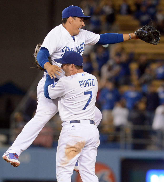 . Nick Punto and Luis Cruz celebrate Yasiel Puig\'s game ending double play against the Padres June 3, 2013 in Los Angeles, CA.  They won the game 2-1.(Andy Holzman/Staff Photographer)