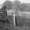 NJ910998A, Man marking Ordnance Survey minor control revision point with an arrow in 1950s