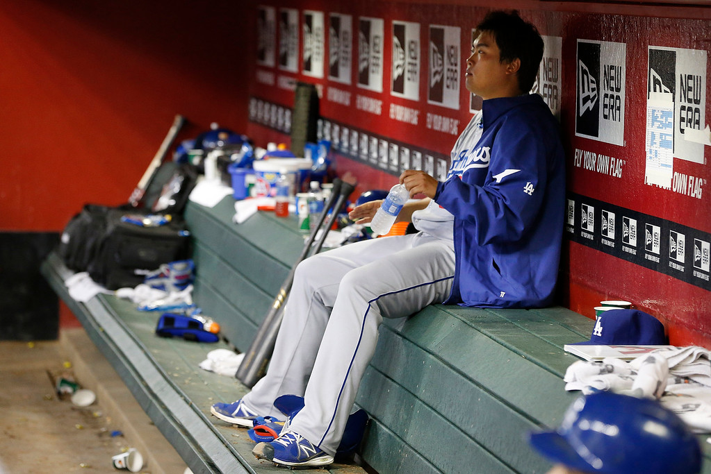 . Los Angeles Dodgers\' Hyun-Jin Ryu, of South Korea, sits on the bench in the ninth inning of a baseball game against the Arizona Diamondbacks on Monday, Sept. 16, 2013, in Phoenix.  The Diamondbacks defeated the Dodgers 2-1. (AP Photo/Ross D. Franklin)