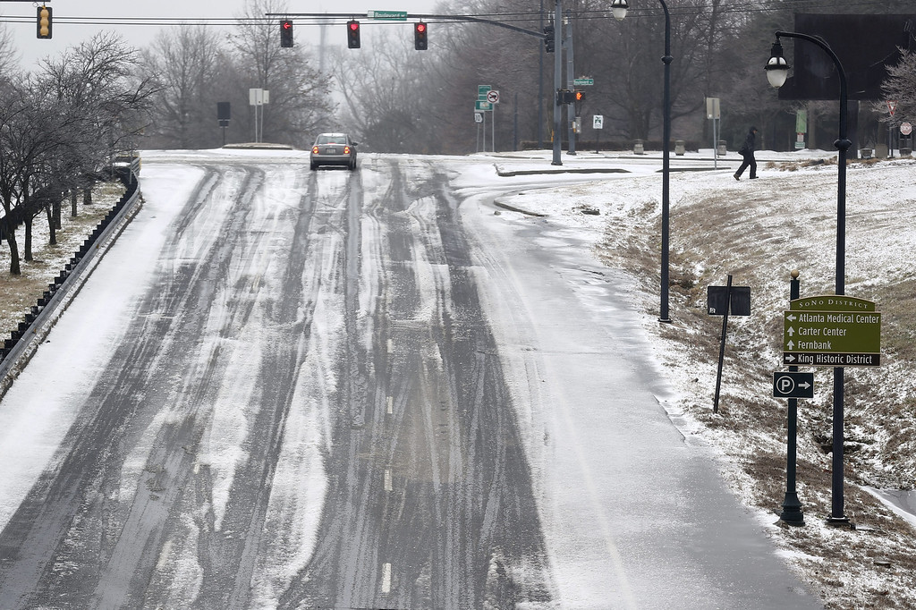 . An ice-covered highway is seen in Atlanta during a severe winter storm in Atlanta, Georgia, USA, 12 February 2014. Ice and snow coming to the metro Atlanta area is expected to make travel treacherous and cut electricity to thousands of customers.  EPA/ERIK S. LESSER
