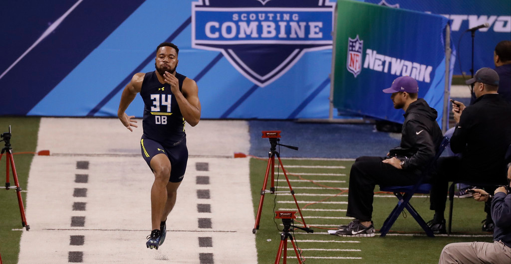 . Ohio State defensive back Marshon Lattimore runs the 40-yard dash at the NFL football scouting combine Monday, March 6, 2017, in Indianapolis. (AP Photo/David J. Phillip)