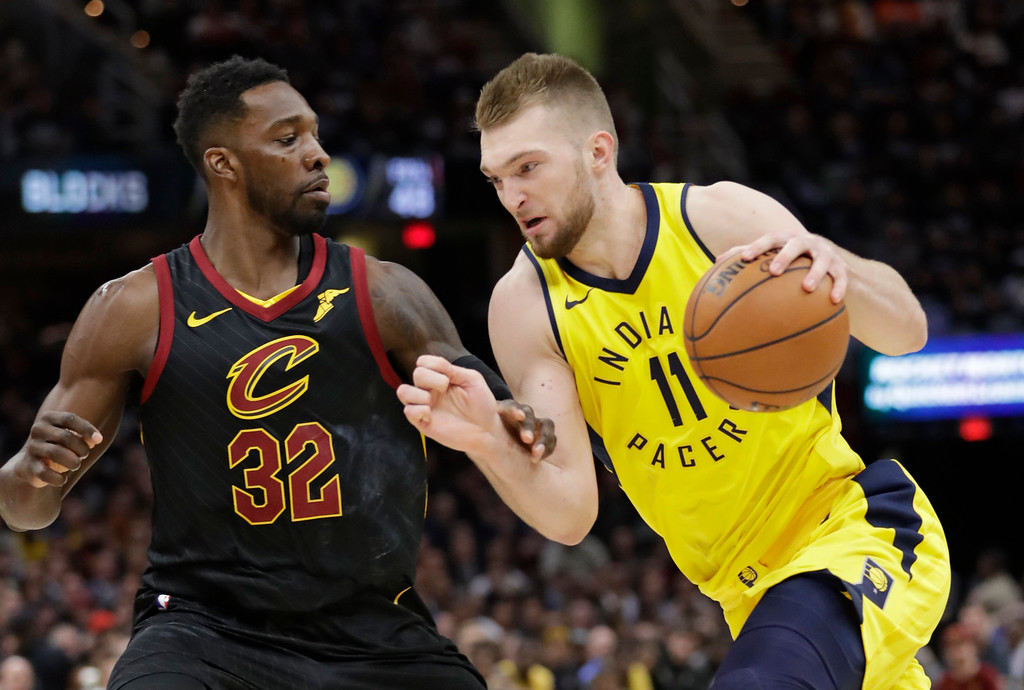 . Indiana Pacers\' Domantas Sabonis (11) drives against Cleveland Cavaliers\' Jeff Green (32) during the second half of Game 2 of an NBA basketball first-round playoff series, Wednesday, April 18, 2018, in Cleveland. The Cavaliers won 100-97. (AP Photo/Tony Dejak)