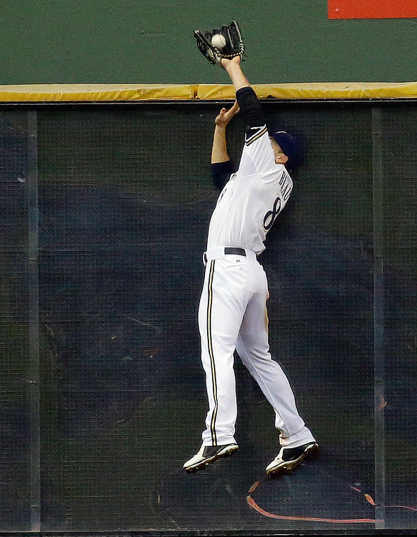 . Milwaukee Brewers left fielder Ryan Braun leaps at the wall to catch a ball hit by Los Angeles Dodgers\' Adrian Gonzalez during the sixth inning of a baseball game Wednesday, May 22, 2013, in Milwaukee. (AP Photo/Morry Gash)