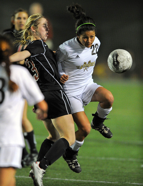 . TORRANCE - 02/12/2013 - (Staff Photo: Scott Varley/LANG) West High girls soccer beat Murrieta Valley on penalty kicks in their CIF Southern Section Division II wild-card matchup. After a 0-0 tie, West won 3-1 on PKs. West\'s Courtney Shoda moves in front of Katie Lewis to head the ball.