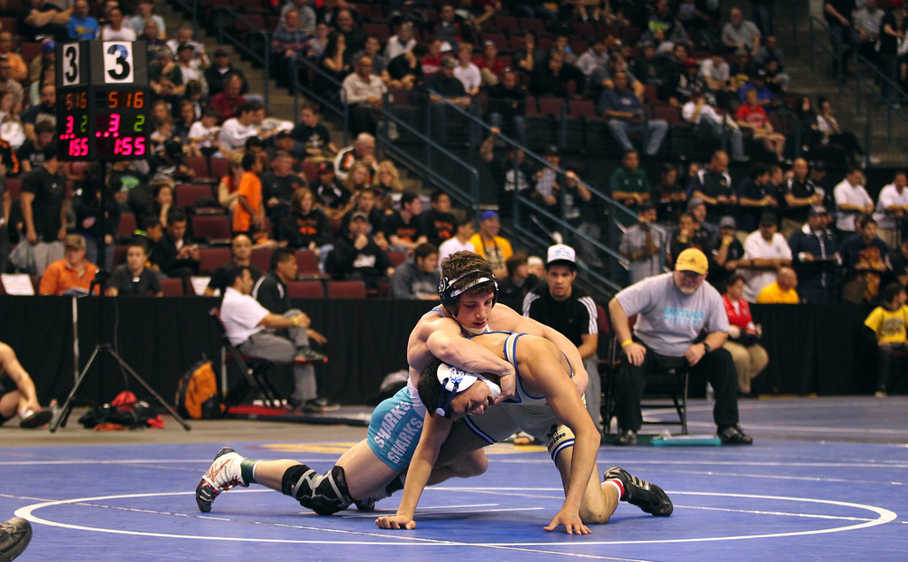 . Gilroy\'s Nikko Villareal, left, wrestles Santiago\'s Mike Longo in a 138-pound fifth round match during the California Interscholastic Federation wrestling championships in Bakersfield, Calif., on Saturday, March 2, 2013. Villareal would go onto win the match and qualify for the finals. (Anda Chu/Staff)