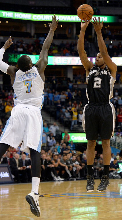 . San Antonio Spurs small forward Kawhi Leonard (2) goes up for a shot over Denver Nuggets power forward J.J. Hickson (7) during the first quarter October 14, 2013 at Pepsi Center. (Photo By John Leyba/The Denver Post)