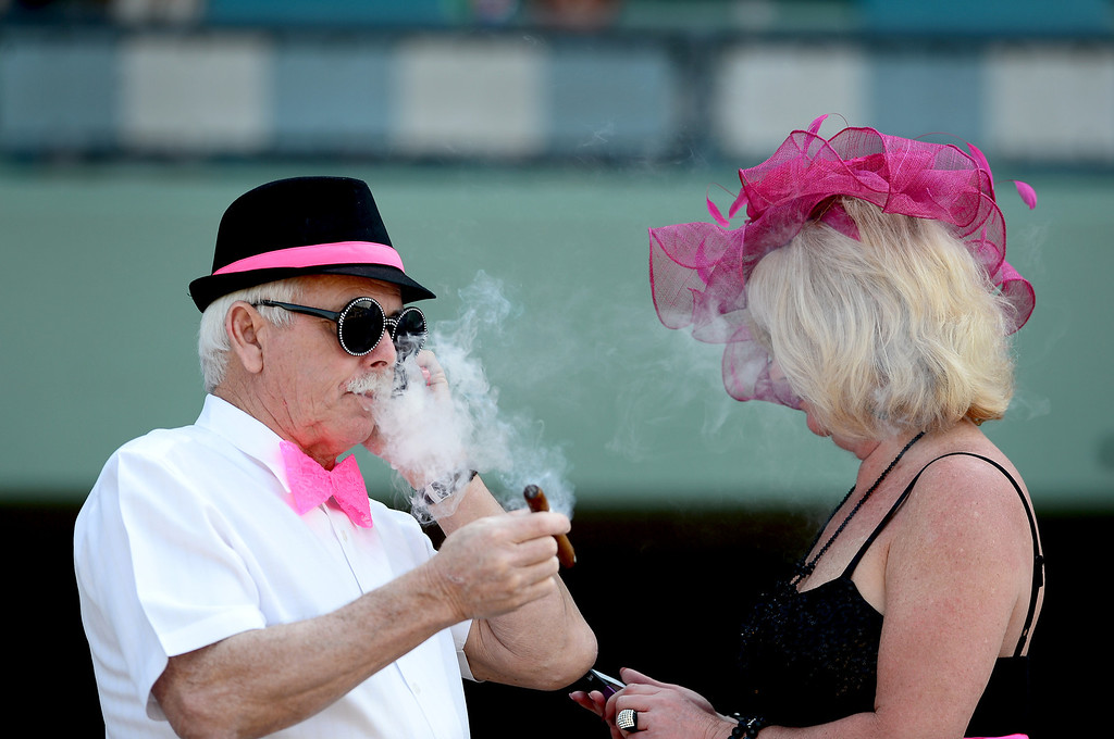 . Paul Burke and Dianne Tanner, of Boston, enjoy the Santa Anita Derby Saturday, April 6, 2013 at Santa Anita Park in Arcadia. Tanner picks the horses and the colors as the two  follow the races across the county. (SGVN/Staff Photo by Sarah Reingewirtz)
