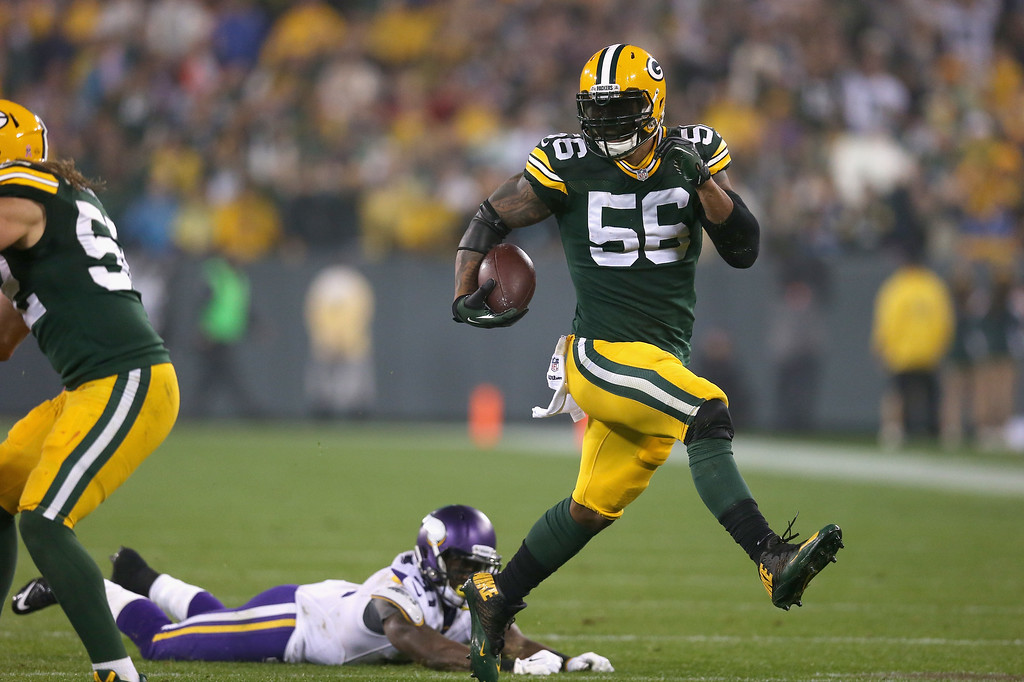 . GREEN BAY, WI - OCTOBER 02:  Julius Peppers #56 of the Green Bay Packers runs the ball for 46 yards on an interception to score against the Minnesota Vikings at Lambeau Field on October 2, 2014 in Green Bay, Wisconsin. (Photo by Jonathan Daniel/Getty Images)