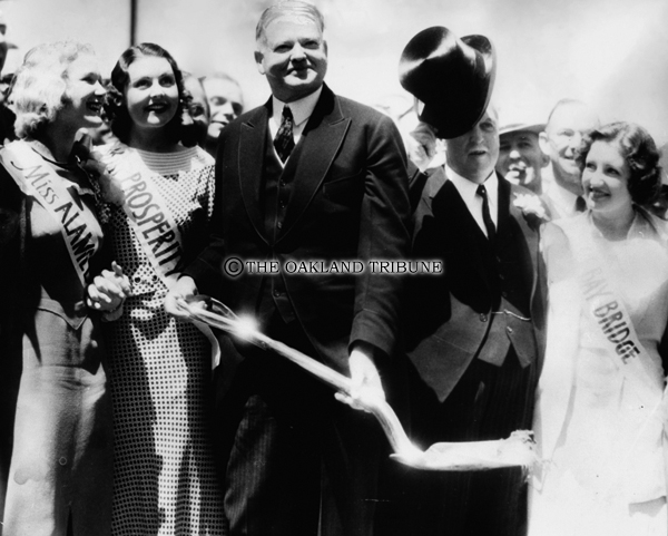 . Yerba Buena Island, CA July 9, 1933 - Former U.S. President Hoover (center) and Governor James Rolph Jr. break ground at ceremonies for the San Francisco Bay Bridge. They are flanked by Miss Alameda, Miss Prosperity and Miss Bay Bridge. (Oakland Tribune Staff Archives)