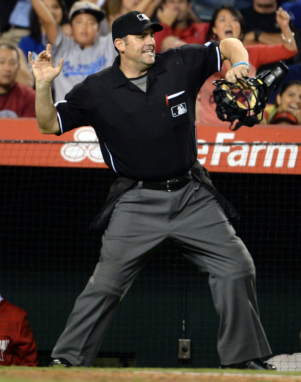 . Home plate umpire Brian Knight ejects Los Angeles Dodgers\' Matt Kemp (not pictured) after striking out looking in the eighth inning of a baseball game against the Los Angeles Angels at Anaheim Stadium in Anaheim, Calif., on Thursday, Aug. 7, 2014.  (Photo by Keith Birmingham/ Pasadena Star-News)