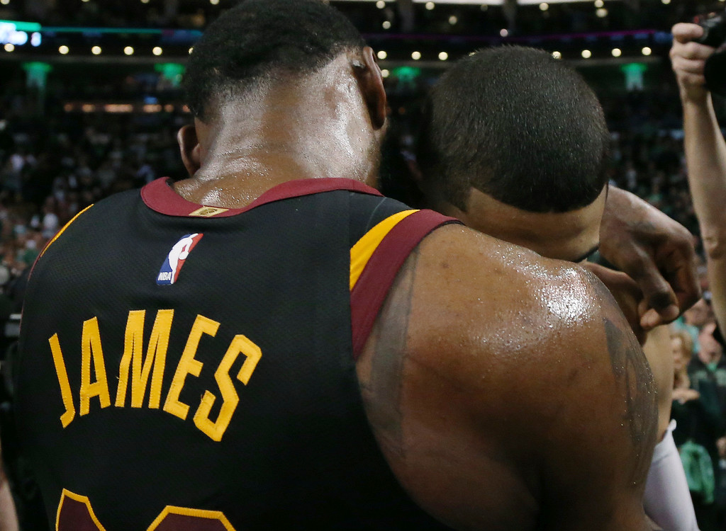. Cleveland Cavaliers forward LeBron James embraces Boston Celtics forward Jayson Tatum after the Cavaliers beat the Celtics 87-79 in Game 7 of the NBA basketball Eastern Conference finals, Sunday, May 27, 2018, in Boston. (AP Photo/Elise Amendola)