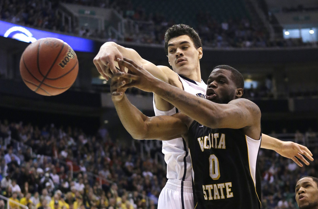 . Wichita State\'s Chadrack Lufile (0) and Pittsburgh\'s Steven Adams (13) go after a rebound in the first half during a second round game in the NCAA college basketball tournament in Salt Lake City Thursday, March 21, 2013. (AP Photo/Rick Bowmer)