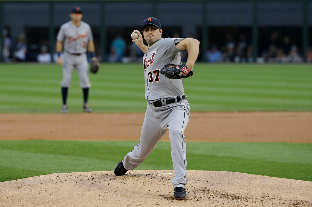 . Detroit Tigers starter Max Scherzer throws against the Chicago White Sox during the first inning of a baseball game in Chicago on Thursday, June 12, 2014. (AP Photo/Nam Y. Huh)